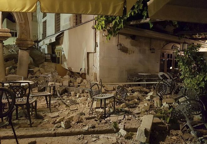A cafe setting is littered with rubble following a strong earthquake on the Greek island of Kos early Friday, July 21, 2017. A powerful earthquake struck Turkey's Aegean coast and nearby Greek islands, sending frightened residents running out of buildings they feared would collapse and into the streets. (Sander van Deventer via AP)