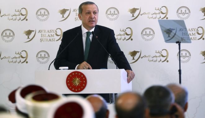 Turkish President Recep Tayyip Erdogan speaks during a meeting on Islam in Eurasia in Istanbul, Tuesday, Oct. 11, 2016. Erdogan says his country is determined to take part in a possible operation to recapture the Iraqi city of Mosul despite objections from Iraq, adding to tensions between the two neighbors. Erdogan on Tuesday also said Turkish troops would not withdraw from a base in northern Iraq near Mosul, where they are training anti-IS fighters Iraqi, saying the Turkish army would not take orders from Baghdad. (Kayhan Ozer, Presidential Press Service, Pool photo via AP)