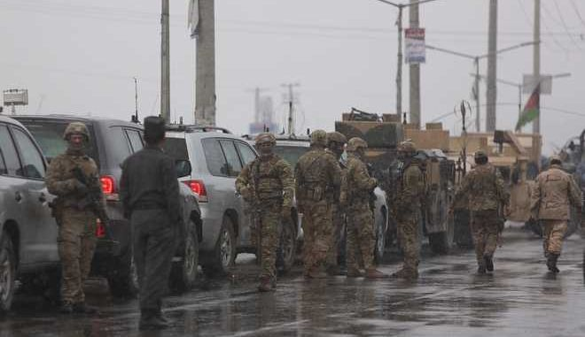 Foreign security personnel arrive at the site of an attack at the Marshal Fahim academy in Kabul, Afghanistan Monday, Jan. 29, 2018. An Afghan official and an eyewitness say blasts have been heard and a gunbattle is occurring near the military academy in the capital Kabul. (AP Photo/Rahmat Gul)