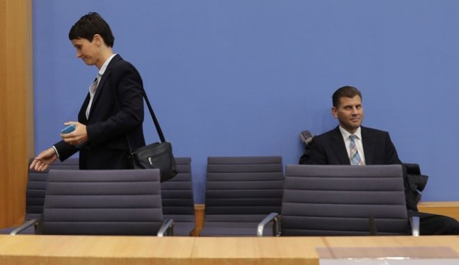 Frauke Petry, co-chairwoman of the AfD, leaves a press conference of the Alternative for Germany, AfD, in Berlin, Germany, Monday, Sept. 25, 2017, where she declared that she won't be part of the party's parliament faction on the day after the nationalist party was elected first time into the German parliament. (AP Photo/Markus Schreiber)