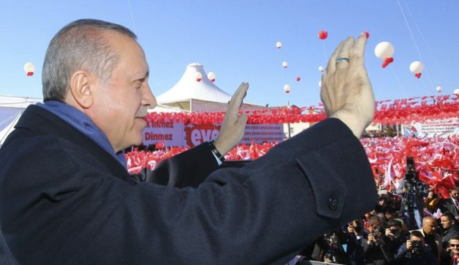 Turkey's President Recep Tayyip Erdogan addresses his supporters in Kastamonu, Turkey, Wednesday, March 22, 2017. Erdogan ramped up his anti-European rhetoric on Wednesday, warning that the safety of Western citizens could be in peril if European nations persist in what he described as arrogant conduct. Erdogan's remarks came amid tension over Dutch and German restrictions on Turkish officials who tried to campaign for diaspora votes ahead of an April 16 referendum on expanding the powers of the Turkish presidency. (Kayhan Ozer/Presidential Press Service, Pool Photo via AP)