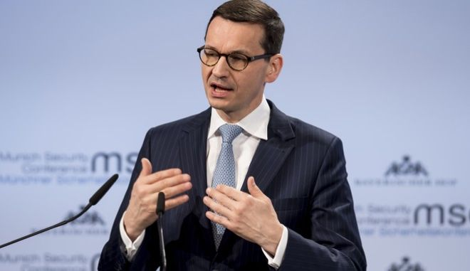 Poland's Prime Minister Mateusz Morawiecki speaks at the Security Conference in Munich, Germany, Saturday, Feb. 17, 2018. (Sven Hoppe/dpa via AP)