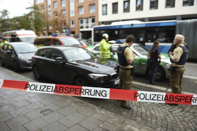Police guard the area at Rosenheimer Platz square in Munich, Germany, Saturday, Oct. 21, 2017. Police say a man with a knife has lightly wounded several  people in Munich. Officers are looking for the assailant. Munich police called on people in the Rosenheimer Platz  square area, located close to the German city's downtown, to stay inside after the incident on Saturday morning. (Andreas Gebert/dpa via AP)
