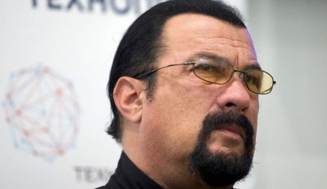 FILE - In this Sept. 22, 2015, file photo, actor Steven Seagal speaks at a news conference, while attending an opening ceremony for a research and development center in Moscow, Russia. Jenny McCarthy said on her Sirius XM show Nov. 9, 2017, that Seagal sexually harassed her during an audition in 1995. A Seagal spokesman has denied the McCarthys accusations to The Daily Beast. (AP Photo/Ivan Sekretarev, File)