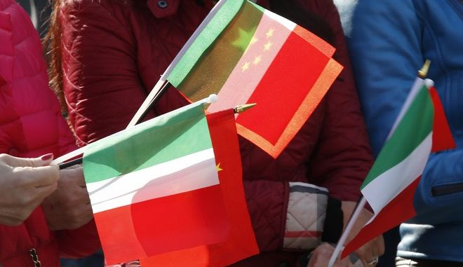 Chinese protesters hold Italian and Chinese flags outside the University of Milan-Bicocca where the Dalai Lama will be made honorary citizen, in Milan, Italy, Thursday, Oct. 20, 2016. The Chinese Embassy in Rome has strongly protested plans by Milan city council to bestow honorary citizenship Thursday on the Dalai Lama, saying it would have a negative impact on bilateral relations and regional cooperation.  (AP Photo/Antonio Calanni)