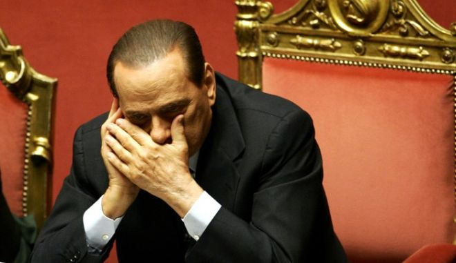 Italian Premier Silvio Berlusconi speaks on a mobile phone prior to a parliament debate, at the Senate in Rome, Tuesday, Dec. 14, 2010. Premier Silvio Berlusconi's political fate lies in the hands of a few swing lawmakers who will decide the outcome of confidence votes in the Italian parliament following a slew of scandals and political infighting. Parliament debate resumes Tuesday with a vote in the Senate scheduled to begin at 1030 GMT (5:30 a.m. EST), which the premier is expected to win. The risk lies in the lower Chamber of Deputies, where Berlusconi's split with longtime ally and Chamber speaker Gianfranco Fini has potentially deprived him of a majority. (AP Photo/Riccardo De Luca)