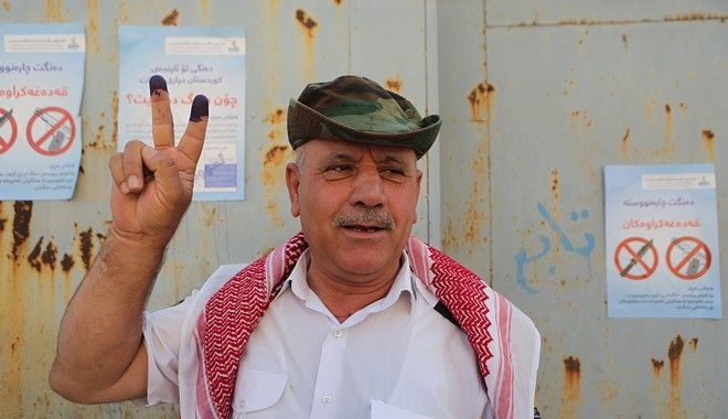An Iraqi Kurdish man poses with his inked fingers after casting a vote during a referendum on independence from Iraq in Irbil, Iraq, Monday, Sept. 25, 2017. Iraqi Shiite lawmaker Hakim al-Zamili, says parliament has approved several tough measures in response to the Iraqi Kurds' contentious vote on independence from Baghdad. The referendum on independence is non-binding, but it has strained tensions with Baghdad and regional powers. (AP Photo/Khalid Mohammed)