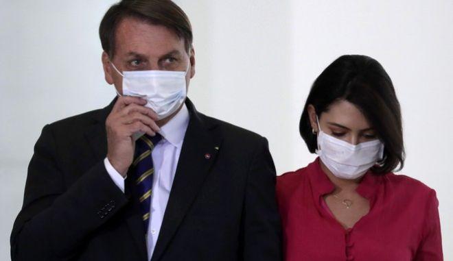 Ο πρόεδρος της Βραζιλίας Μπολσονάρου και η σύζυγός του Μισέλ.