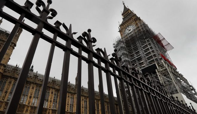 Scaffolding stands around the London landmark Big Ben, almost up to the clock face, in London, Wednesday, Oct. 11, 2017. A programme of essential works to conserve the Elizabeth Tower, the Great Clock and the Great Bell, also known as Big Ben is now estimated at 61 million pounds as opposed to 29 million pounds as estimated in spring 2016. (AP Photo/Kirsty Wigglesworth)