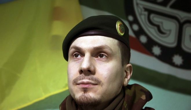 FILE - This March 2, 2015 file photo shows Adam Osmayev, the commander of a battalion of Chechens fighting against Russia-backed rebels, in the town of Lysychansk, Ukraine. A Ukrainian lawmaker said that Adam Osmayev was wounded when a vehicle he was driving was shot at near Kiev Monday, Oct. 30, 2017. (AP Photo/Olya Engalycheva, file)