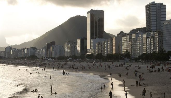 "FILE - In this Dec. 26, 2013, file photo, hotels and apartment buildings line the Copacabana beach shore in Rio de Janeiro, Brazil. The head of a sports travel agency specializing in packages for the Rio de Janeiro 2016 Olympics said that the company's business could be devastated if the Zika virus, or rumors about it, continue to spread. ""It could be catastrophic,"" according to Jerri Roush, executive vice-president of Cartan Tours. (AP Photo/Silvia Izquierdo, File)"