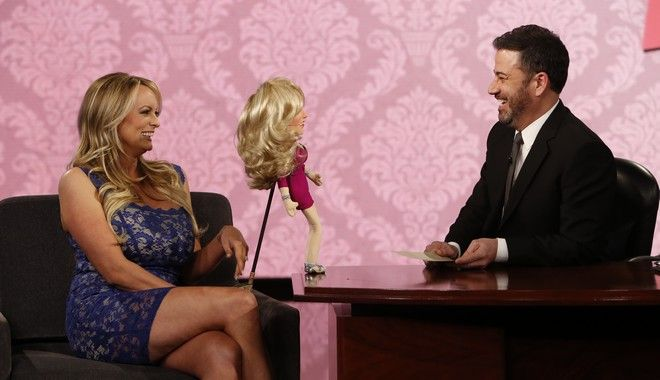 This image released by ABC shows adult film star Stormy Daniels, left, with host Jimmy Kimmel on