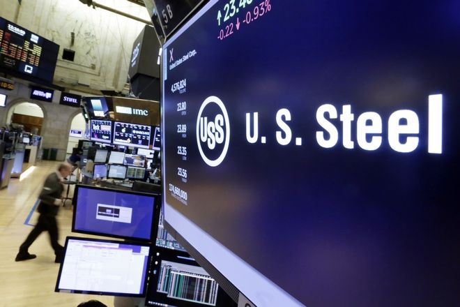 The US Steel logo appears above a trading post above the floor of the New York Stock Exchange, Monday, July 24, 2017. (AP Photo/Richard Drew)