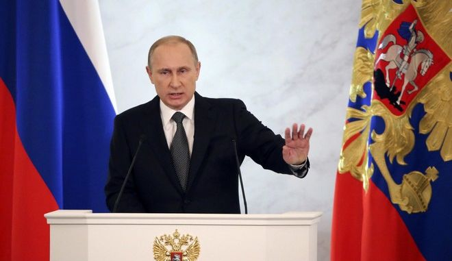 Russia's President Vladimir Putin addresses the Federal Assembly, including State Duma deputies, members of the Federation Council, the heads of the Constitutional and Supreme courts, regional governors, heads of Russia's traditional religious faiths and public figures at the Kremlin in Moscow, December 4, 2014. Putin proposed an amnesty on Thursday for those returning capital to Russia, indicating they would not face tax or other penalties. REUTERS/Sergei Karpukhin (RUSSIA - Tags: POLITICS BUSINESS)