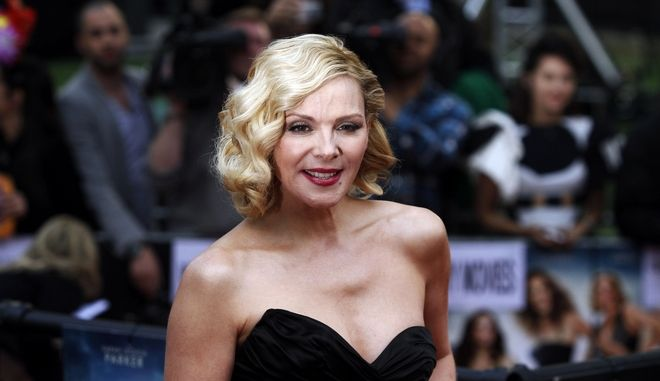 Actress Kim Cattrall poses for the photographers as she arrives for the British premiere of the film 'Sex and the City 2', at a central London cinema, on Thursday, May 27, 2010. (AP Photo/Lefteris Pitarakis)