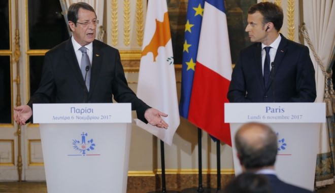Cyprus President Nicos Anastasiades , left, and French President Emmanuel Macron make declarations after a bilateral meeting at the Elysee Palace in Paris, France, Monday, Nov. 6, 2017. (AP Photo/Michel Euler, Pool)