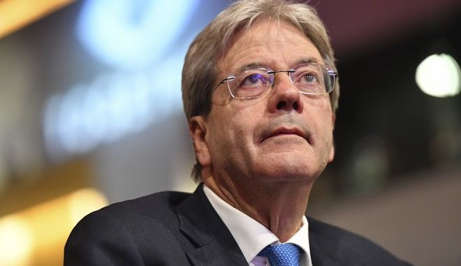 Italian Prime Minister Paolo Gentiloni arrives for a meeting of European Socialists prior to an EU summit in Brussels on Thursday, Oct. 19, 2017. European Union leaders are gathering for a two day summit to discuss migration, digital economy and Brexit. (AP Photo/Geert Vanden Wijngaert)