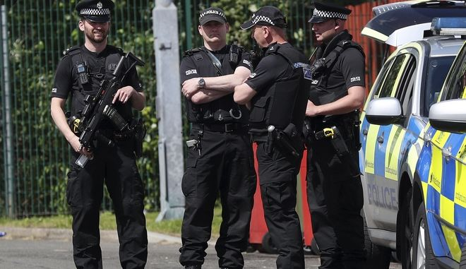Armed police officers stand outside the stadium ahead of the World Cup Group F qualifying soccer match between Scotland and England at Hampden Park, Glasgow, Scotland, Saturday, June 10, 2017. (AP Photo/Scott Heppell)