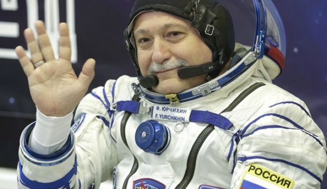 Russian cosmonaut Fyodor Yurchikhin, a member of the main crew of the expedition to the International Space Station (ISS), gestures prior to the launch of Soyuz MS-04 spacecraft at the Russian leased Baikonur cosmodrome, Kazakhstan, Thursday, April 20, 2017. (AP Photo/Dmitri Lovetsky)