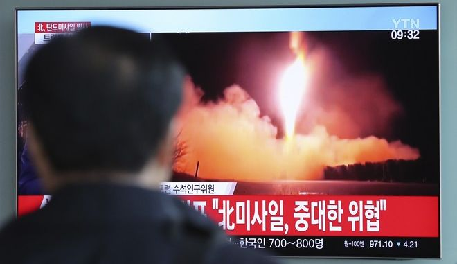 """A man watches a TV screen showing a local news program reporting with a file footage of North Korea's missile launch, at the Seoul Railway Station in Seoul, South Korea, Wednesday, Nov. 29, 2017. After 2 ½ months of relative peace, North Korea launched its most powerful weapon yet early Wednesday, a presumed intercontinental ballistic missile that could put Washington and the entire eastern U.S. seaboard within range. The letters read """"North Korea's missile launch, serious threat."""" (AP Photo/Lee Jin-man)"""