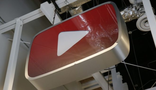 A logo hangs from the ceiling in the YouTube Space LA offices production equipment room Wednesday, Oct. 21, 2015, in Los Angeles. (AP Photo/Danny Moloshok)