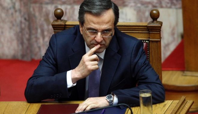 Greece's Prime Minister Antonis Samaras gestures during a parliament session in Athens July 6, 2012. Greece will not demand changes to overall targets included in its bailout plan but will renegotiate policies it feels are preventing it from hitting those goals, Prime Minister Antonis Samaras said in his first policy speech since taking office.  REUTERS/John Kolesidis (GREECE - Tags: POLITICS)
