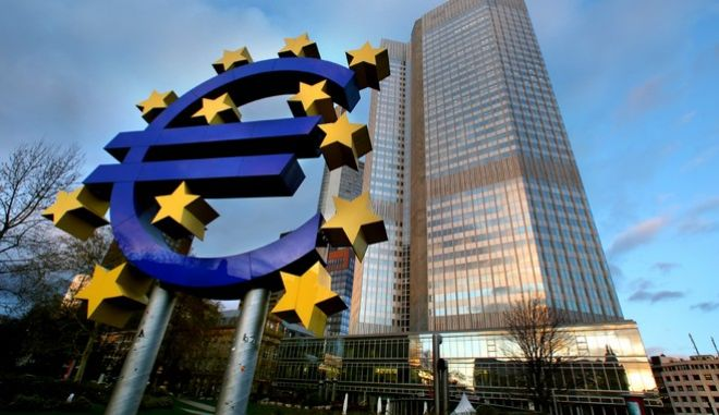 "The euro sign sculpture stands outside the European Central Bank (ECB) headquarters in Frankfurt, Germany, on Thursday, Dec. 3, 2009. ECB President Jean-ClaueTrichet said the ECB will scale back its flagship emergency financing operations next year as the euro region starts an ""uneven"" recovery. Photographer: Hannelore Foerster/Bloomberg"