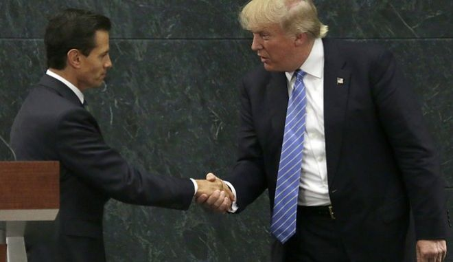 In this Aug. 31, 2016 photo, Mexico's President Enrique Pena Nieto and Republican presidential nominee Donald Trump shake hands after a joint statement at Los Pinos, the presidential official residence, in Mexico City. Trump is calling his surprise visit to Mexico City Wednesday a 'great honor.' The Republican presidential nominee said after meeting with Pena Nieto that the pair had a substantive, direct and constructive exchange of ideas.v(AP Photo/Marco Ugarte)