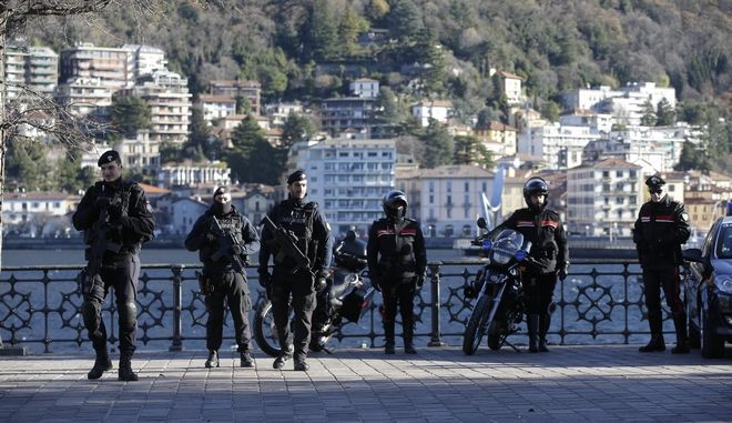 Carabinieri officers patrol during a demonstration staged by the Democratic party, in Como, Italy, Saturday, Dec. 9, 2017. (AP Photo/Luca Bruno)
