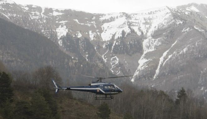 A rescue helicopter takes off from La Seyne les Alpes, French Alps, Tuesday, March 24, 2015, as search-and-rescue teams struggle to reach the remote, snow-covered crash site of Germanwings passenger plane.  A Germanwings passenger jet carrying 150 people crashed Tuesday in the French Alps as it flew from Spain's Barcelona airport to Duesseldorf, authorities said.  (AP Photo/Claude Paris)