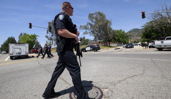 A police office stands guard outside North Park School after a fatal shooting at the elementary school, Monday, April 10, 2017, in San Bernardino, Calif. (AP Photo/Ringo H.W. Chiu)