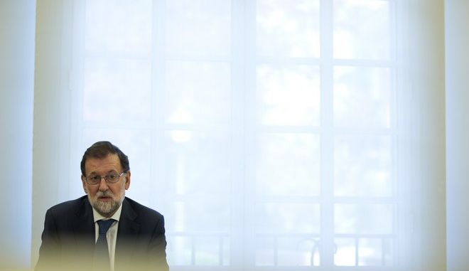 Spain's Prime Minister Mariano Rajoy talks to Socialist party leader Pedro Sanchez during their meeting at the Moncloa palace in Madrid, Thursday, Sept. 7, 2017. Rajoy and members of his cabinet met Thursday to react to plans by Catalan leaders who scheduled a vote on the regions independence from Spain. (AP Photo/Francisco Seco)
