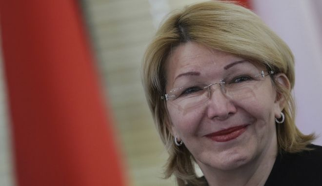"""Venezuela's ousted Chief Prosecutor Luisa Ortega Diaz attends a meeting of Mercosur trade bloc prosecutors, in Brasilia, Brazil, Wednesday, Aug. 23, 2017. Brazil's attorney general is sharply criticizing the recent ouster of his counterpart in Venezuela. Attorney General Rodrigo Janot said that the removal of Ortega Diaz was """"an institutional rape"""" and that it eroded the independence of Venezuela's justice system. (AP Photo/Eraldo Peres)"""