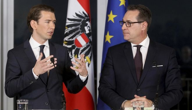 Foreign Minister and leader of the Austrian People's Party, OEVP, Sebastian Kurz and Heinz-Christian Strache, chairman of the right-wing Freedom Party, FPOE, from left, talk during a joint news conference after forming a new coalition government in Vienna, Austria, Saturday, Dec. 16, 2017. (AP Photo/Ronald Zak)