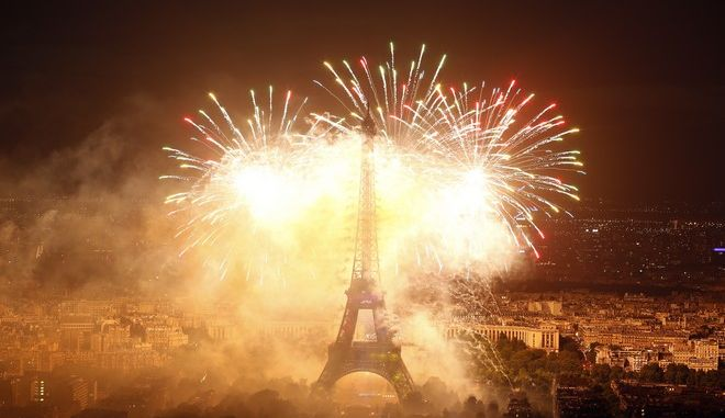 A view of  the fireworks display by the Eiffel Tower on Bastille Day,  in Paris, France, Friday, July 14, 2017.  (AP Photo/Matthieu Alexandre)