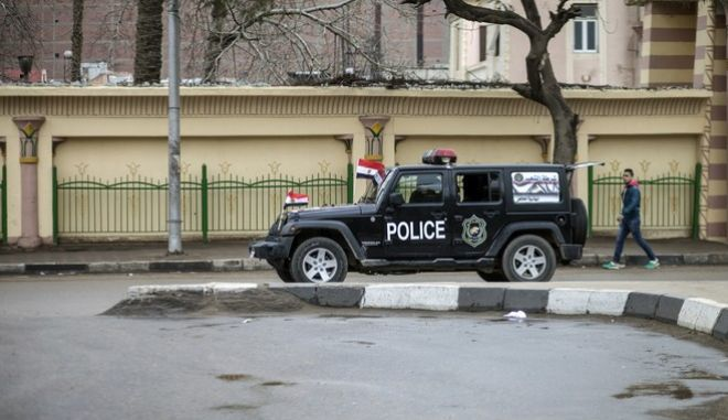 A boy walks past a police vehicle patrolling the streets, on the fifth anniversary of the 2011 uprising that ousted autocrat Hosni Mubarak, in the Haram district of Cairo, Egypt, Monday, Jan. 25, 2016. The uprising failed to bring about the goals of democracy and freedom the pro-democracy youths who spearheaded the 'revolution' had espoused. The run-up to the anniversary has seen stepped-up security measures as well as a new wave of arrests and security checks in downtown. (AP Photo)