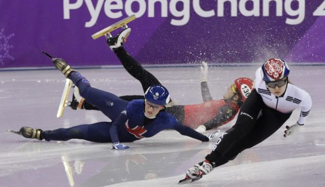 Choi Min-jeong of South Korea races ahead of Elise Christie, left, of Britain and Li Jinyu of China as they crash out of their women's 1500 meters short track speedskating semifinal in the Gangneung Ice Arena at the 2018 Winter Olympics in Gangneung, South Korea, Saturday, Feb. 17, 2018. (AP Photo/David J. Phillip, File)