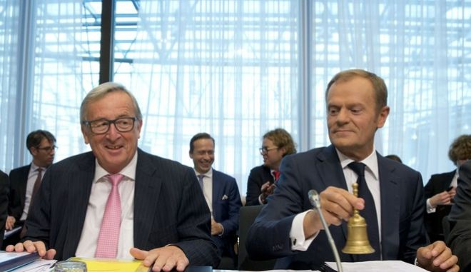 European Commission President Jean-Claude Juncker, left, and European Council President Donald Tusk participate in a Tripartite Social Summit in Brussels on Wednesday, Oct. 18, 2017. EU officials met social partners one day ahead of an EU summit to promote social and economic progress. (AP Photo/Virginia Mayo)