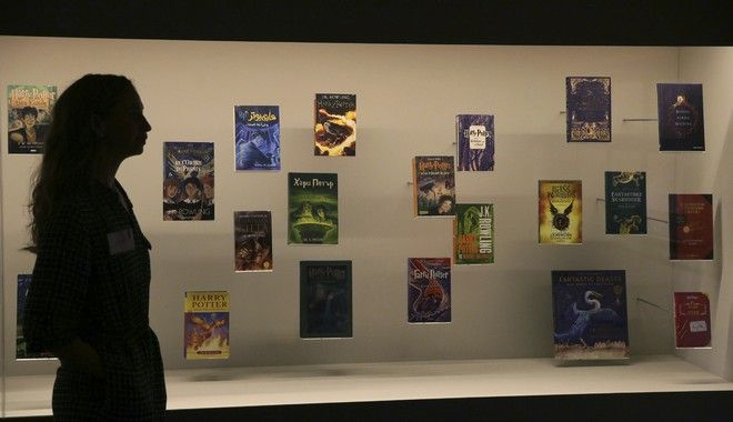 A member of British Library staff poses for a picture with Harry Potter books published in several languages at the