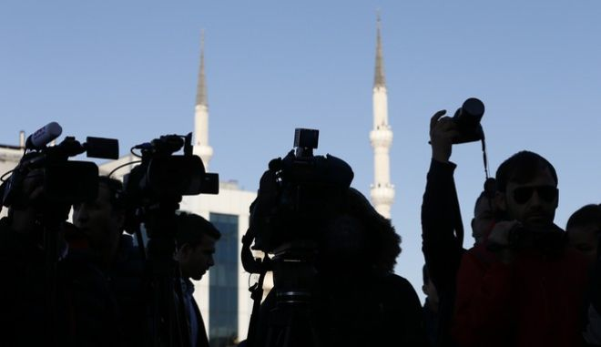 Members of the media cover a protest outside a court where the trial of about a dozen employees of the Cumhuriyet daily newspaper on charges of aiding terror groups, continues in Istanbul, Tuesday, Oct. 31, 2017. Most of the staff were released from prison earlier this month, but four of them, including editor-in-chief Murat Sabuncu and investigative journalist Ahmet Sik, are still in prison. (AP Photo/Lefteris Pitarakis)