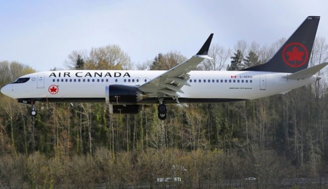 A Boeing 737 MAX 8 operated by Air Canada lands Wednesday, March 27, 2019, at Boeing Field in Seattle. The Federal Aviation Administration plans to revamp oversight of airplane development after the two deadly crashes of 737 Max 8 airplanes, according to testimony prepared for a Capitol Hill hearing on Wednesday. (AP Photo/Ted S. Warren)