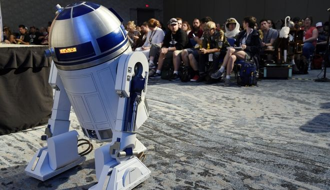 """""""Star Wars"""" robot character R2-D2 stands in front of the audience at the Princess Leia Star Wars Fan Club Tribute Presentation during the 2017 Comic-Con International on Sunday, July 23, 2017, in San Diego, Calif. (Photo by Chris Pizzello/Invision/AP)"""