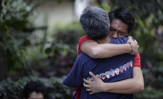 Men hug, crying with joy, as they reunite hours after an earthquake in the Condesa neighborhood of Mexico City, Tuesday, Sept. 19, 2017. A 7.1 earthquake stunned central Mexico, killing more than 100 people as buildings collapsed in plumes of dust. (AP Photo/Rebecca Blackwell)
