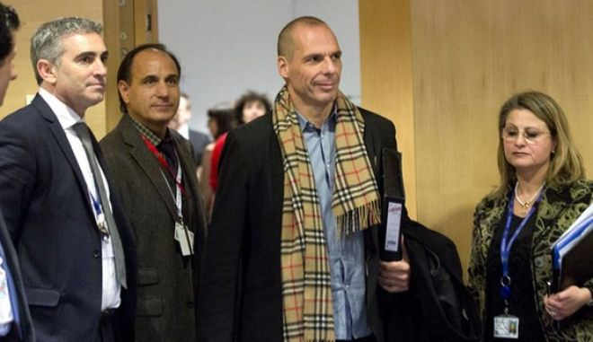 Greek Finance Minister Yanis Varoufakis, second right, arrives for a meeting of eurogroup finance ministers in Brussels on Wednesday, Feb. 11, 2015. Leading European officials downplayed expectations that a comprehensive debt deal with Greece is likely Wednesday at an emergency meeting in which Greece¢s finance minister is set to unveil a plan to loosen austerity¢s grip on his economy. (AP Photo/Virginia Mayo)