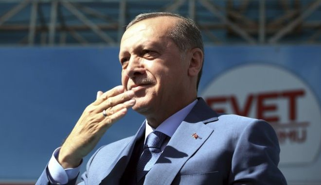 Turkey's President Recep Tayyip Erdogan gestures as he addresses his supporters during a referendum rally in Sanliurfa, Turkey, Tuesday, April 11, 2017. Turkey is heading to a contentious April 16 referendum on constitutional reforms to expand Erdogan's powers.(Yasin Bulbul/Presidential Press Service, Pool Photo via AP)