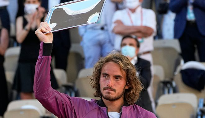 Stefanos Tsitsipas of Greece shows his trophy after losing to Serbia's Novak Djokovic in their final match of the French Open tennis tournament at the Roland Garros stadium Sunday, June 13, 2021 in Paris. Djokovic won 6-7 (6), 2-6, 6-3, 6-2, 6-4. (AP Photo/Michel Euler)
