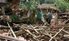 Members of a family remove debris from their destroyed home in the village of Sissano in northern Papua New Guinea, Monday, July 20, 1998. A wall of water, stirred up by a magnitude-7 undersea earthquake, destroyed at least three villages Friday night when it crashed into the northwest coast of Papua New Guinea.(AP photo/Brian Cassey)