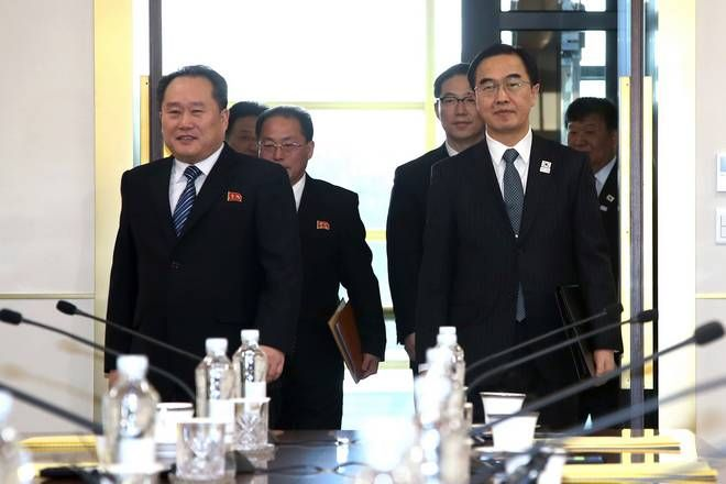 South Korean Unification Minister Cho Myoung-gyon, right, and head of North Korean delegation Ri Son Gwon, left, arrive to hold their meeting at the Panmunjom in the Demilitarized Zone in Paju, South Korea, Tuesday, Jan. 9, 2018. Senior officials from the rival Koreas said Tuesday they would try to achieve a breakthrough in their long-strained ties as they sat for rare talks at the border to discuss how to cooperate in next month's Winter Olympics in the South and other issues. (Korea Pool via AP)