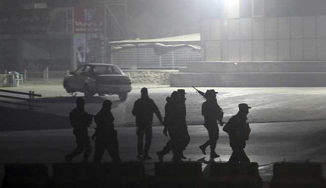 Security forces walk towards the Intercontinental Hotel after a deadly attack in Kabul, Afghanistan, Saturday, Jan. 20, 2018. An Afghan official says that a group of gunmen have attacked the Intercontinental Hotel in the capital Kabul. (AP Photo/Massoud Hossaini)
