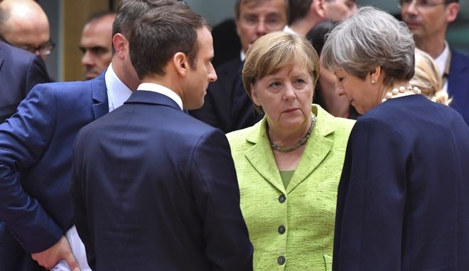 Η ΕΕ να αμυνθεί εναντίον ενδεχόμενων εμπορικών μέτρων από τις ΗΠΑ, ζητούν Μέρκελ, Μακρόν και Μέι